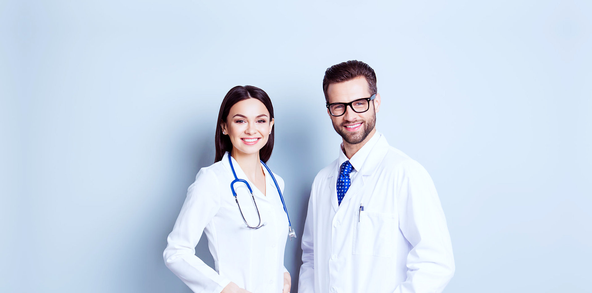 male and female doctor smiling