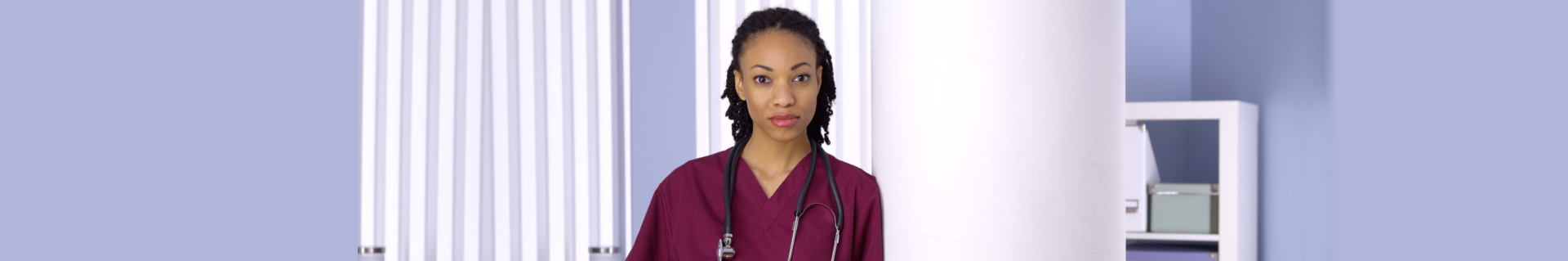 Black woman nurse standing in office