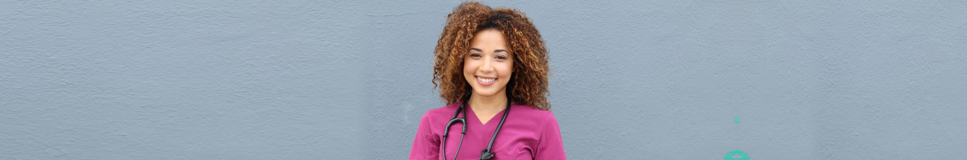 Beautiful african american female pediatric nurse holding pen and paper